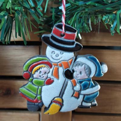 Les enfants au bonhomme de neige